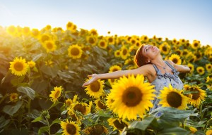 Happy woman sunflowers